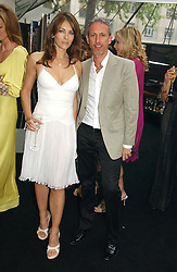 LIZ HURLEY and PATRICK COX at the 2006 Glamour Women of the Year Awards 2006 held in Berkeley Square Gardens, London W1 on 6th June 2006.<br />