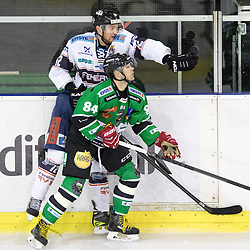 14.12.2014, Hala Tivoli, Ljubljana, SLO, EBEL, HDD Telemach Olimpija Ljubljana vs Fehervar AV19, 27. Runde, in picture Andras Benk (Fehervar AV19, #12) vs Andrej Hebar (HDD Telemach Olimpija, #84) during the Erste Bank Icehockey League 27. Round between HDD Telemach Olimpija Ljubljana and Fehervar AV19 at the Hala Tivoli, Ljubljana, Slovenia on 2014/12/14. Photo by Matic Klansek Velej / Sportida