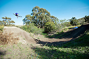 Marshall Mullen demonstrates a flat 360 on his mini slopestyle course in Malibu, California.