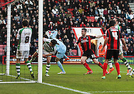 Picture by Tom Smith/Focus Images Ltd 07545141164<br /> 26/12/2013<br /> Elliot Ward (3rd right) of Bournemouth puts the ball in the net but it is not allowed during the Sky Bet Championship match at the Goldsands Stadium, Bournemouth.