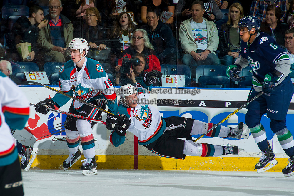 KELOWNA, CANADA - APRIL 26: Calvin Thurkauf #27 of the Kelowna Rockets loses his footing after a back check by Aaron Hyman #6 of the Seattle Thunderbirds on April 26, 2017 at Prospera Place in Kelowna, British Columbia, Canada.  (Photo by Marissa Baecker/Shoot the Breeze)  *** Local Caption ***