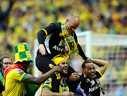 Norwich City Manager, Alex Neil is held aloft by Norwich City's Bradley Johnson as Norwich City win promotion to the premier league   - Photo mandatory by-line: Joe Meredith/JMP - Mobile: 07966 386802 - 25/05/2015 - SPORT - Football - London - Wembley Stadium - Middlesbrough v Norwich - Sky Bet Championship - Play-Off Final