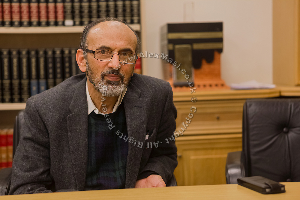 Niaz Ahmed, a trustee of Birmingham Central Mosque, is sitting at his desk.