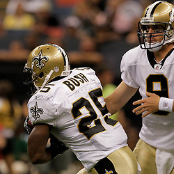 2009 August 14: New Orleans Saints quarterback Drew Brees (9) hands off to running back Reggie Bush (25)  during a preseason opener between the Cincinnati Bengals and the New Orleans Saints at the Louisiana Superdome in New Orleans, Louisiana.