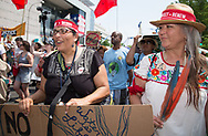 Cherri Foytlin marching with Pennie Opal Plant in the Climate March in Washignton D.C.
