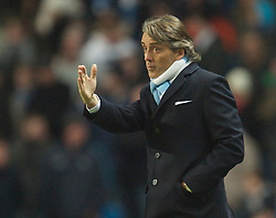 MANCHESTER, ENGLAND - Sunday, February 13, 2010: Manchester City's manager Roberto Mancini during the FA Cup 5th Round match against Stoke City at the City of Manchester Stadium. (Photo by David Rawcliffe/Propaganda)  MANCHESTER, ENGLAND - Sunday, February 13, 2010: Manchester City xxxx and Stoke City's xxxx during the FA Cup 5th Round match at the City of Manchester Stadium. (Photo by David Rawcliffe/Propaganda)
