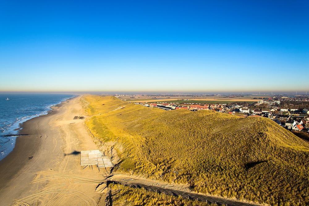 Nederland, Noord-Holland, Gemeente Schagen, 11-12-2013; de duinen bij het dorp Callantsoog gezien vanuit zee. Duinopgang met plankieren van strandtent. De duinenrij is slechts een duin breed, de kust moet versterkt.<br /> The dunes near the village of Callantsoog seen from the sea. The coastal dunes count only one dune, strengthening of the dunens is needed.<br /> luchtfoto (toeslag op standard tarieven);<br /> aerial photo (additional fee required);<br /> copyright foto/photo Siebe Swart