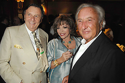 Left to right, BARRY HUMPHRIES, JOAN COLLINS and MICHAEL WINNER at a party to celebrate the 180th Anniversary of The Spectator magazine, held at the Hyatt Regency London - The Churchill, 30 Portman Square, London on 7th May 2008.<br />