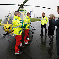 FREE TO USE PHOTOGRAPH....30.10.15<br /> Scotland's Charity Air Ambulance (SCAA) unveiled it's new helicopter at Perth airport this morning a EC135 T2i (pictured) which replaces the Bolkow 105 helicopter which is retiring from service. The new helicopter will increase speed, range, endurance and payload, allow SCAA to fly at night and in cloud. Minister for Health Shona Robison and SCAA Chairman John Bullough with the crew of the retiring Bolkow 105<br /> for further info please contact Maureen Young on 07778 779000<br /> Picture by Graeme Hart.<br /> Copyright Perthshire Picture Agency<br /> Tel: 01738 623350  Mobile: 07990 594431