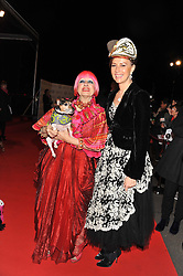 Left to right, ZANDRA RHODES holding Lilly Langtry the dog and KATHARINA FLOHR Fabergé's Managing and Creative Director at the Battersea Dogs & Cats Home Collars & Coats Gala Ball held at Battersea Evolution, Battersea Park, London SW8 on 8th November 2012.