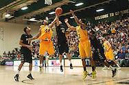 Catamounts guard Dre Wills (24) and Binghamton's Willie Rodriguez (42) battle for the rebound during the men's basketball game between the Binghamton Bearcats and the Vermont Catamounts at Patrick Gym on Monday night January 19, 2015 in Burlington, Vermont. (BRIAN JENKINS, for the Free Press)