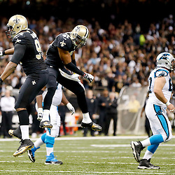Dec 8, 2013; New Orleans, LA, USA; New Orleans Saints defensive end Cameron Jordan (94) celebrates with teammate strong safety Roman Harper (41) after sacking Carolina Panthers quarterback Cam Newton (not pictured) during the first half of a game at Mercedes-Benz Superdome. Mandatory Credit: Derick E. Hingle-USA TODAY Sports