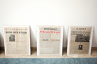 """AFFILE, ITALY - 23 AUGUST 2012: Newspapers of 1951 featuring fascist Marsahll Rodolfo Graziani are exposed in the mausoleum dedicated to him in Affile, a town with a population of 1,600 80km east of Rome, on August 23, 2012. A mausoleum and park, dedicated to the memory of Fascist Field Marshall Rodolfo Graziani, has recently been opened in the Italian town of Affile. At a cost of €127,000 to local taxpayers, the mayor Ercole Viri has expressed hope that the site will become as 'famous and as popular as Predappio' – the burial place of Mussolini which has become a shrine to neo-Fascists. Rodolfo Graziani was the youngest colonel in the Regio Esercito (Royal Italian Army), known as the """"Butcher of Fezzan"""" and the """"Butcher of Ethiopia"""" for the brutal military campaigns and gas attacks he led in Libya and Ethiopia under the dictatorship of Benito Mussolini under which he then became Minister of Defence from 1943 to 1945."""