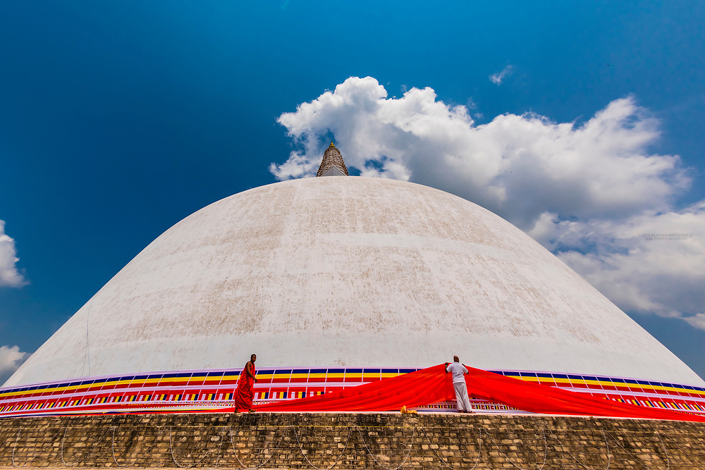Ruwanwelisaya Dagoba (Stupa) in the ancient city of Anuradhapura, Sri Lanka. Also known as the Ruwanweli Maha Seya, or Great Stupa is a sacred place of pilgrimage and worship in the ancient city of Anuradhapura.