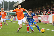 Andy Barcham of AFC Wimbledon and Stephen O'Donnell of Luton Town tussle during the Sky Bet League 2 match between AFC Wimbledon and Luton Town at the Cherry Red Records Stadium, Kingston, England on 13 February 2016. Photo by Stuart Butcher.