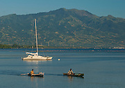 Fishers and catamaran, Maumere beach, Flores.