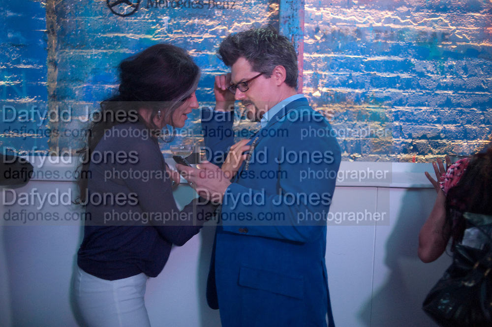 DAGMAR DE BEERS; AJ DE BEERS, Giles Deacon after-show party. Elm lester painting rooms. Leicester Sq. London. 19 September 2011. <br /> <br />  , -DO NOT ARCHIVE-© Copyright Photograph by Dafydd Jones. 248 Clapham Rd. London SW9 0PZ. Tel 0207 820 0771. www.dafjones.com.