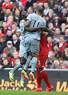 Yoan Gouffran of Newcastle United celebrates with Massadio Ha&iuml;dara after Martin Skrtel of Liverpool scores an own goal during the Barclays Premier League match at Anfield, Liverpool.Picture by Michael Sedgwick/Focus Images Ltd +44 7900 363072<br /> 11/05/2014