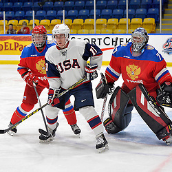 WHITBY, - Dec 17, 2015 -  Game #10 - United States vs. Russia at the 2015 World Junior A Challenge at the Iroquois Park Recreation Complex, ON.  Callahan Burke #11 of Team United States gets into position in front of Dmitrii Alekseev #8 and goaltender Vladislav Sukhachev #77 of Team Russia during the second period.<br /> (Photo: Shawn Muir / OJHL Images)