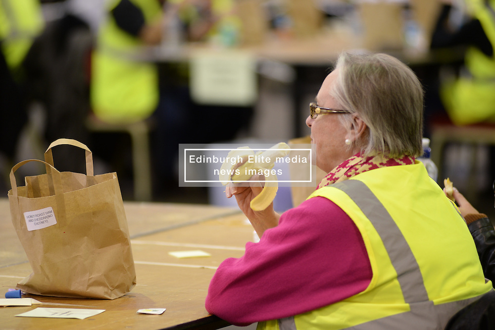 A counter takes a break during the Edinburgh count at Ingliston.<br /> © Dave Johnston/ EEm