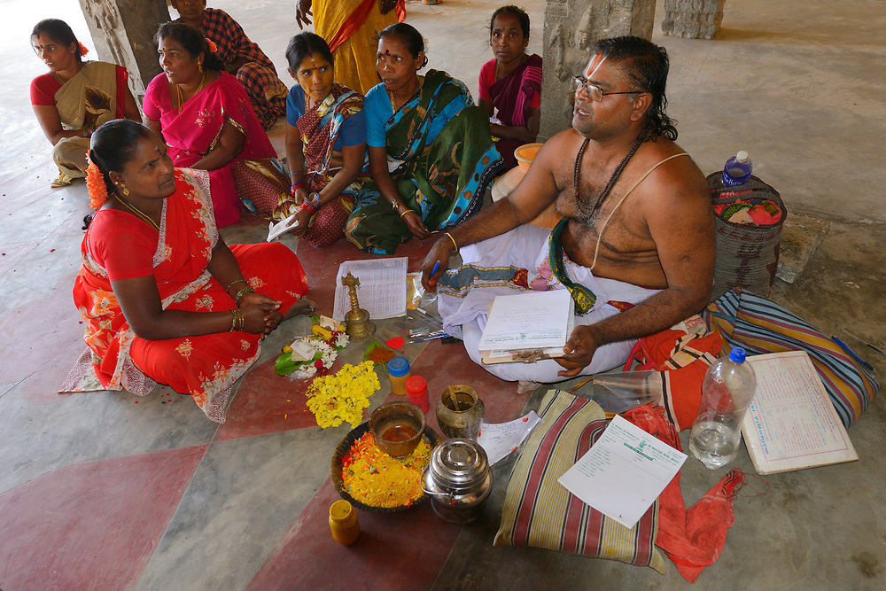 Hindus getting advice from a Swami in the Hindu temple, Pulicat town, Pulicat Lake, Tamil Nadu, India