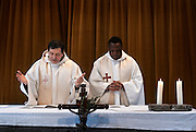 Belgium - Liege April 04, 2007, Belgian Priest and Burundese priest are celebrating mass at St-Martin Basilica ©Jean-Michel Clajot