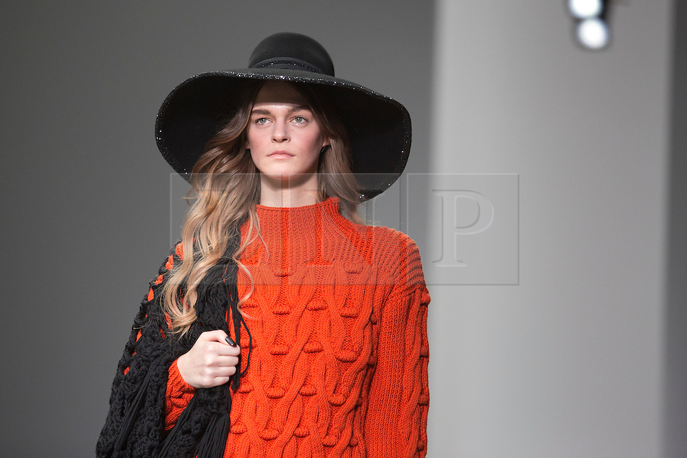 © Licensed to London News Pictures. 15 February 2014, London, England, UK. A model walks the runway at the Sister by Sibling show during London Fashion Week AW14 at Somerset House. Photo credit: Bettina Strenske/LNP