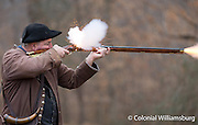 Gunsmith George Suiter firing a rifle