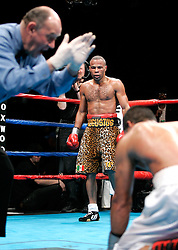 February 10, 2006 - Mashantucket, CT - Emanuel Augustus watches as Jaime Rangel is given a count during the 10th round of their fight.  Augustus rallied to win via 10th round TKO.
