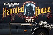 The detail of a scraped van's side promoting local horror entertainment including skulls, on 14th July 2017, at Filey, North Yorkshire, England.