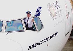 An Emirates pilot flies the Scottish Saltire to mark the inaugural flight today between Edinburgh and Dubai. pic copyright Terry Murden @edinburghelitemedia