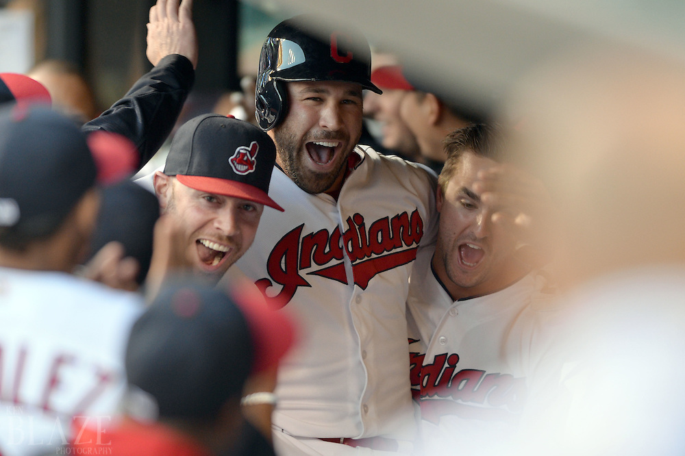 Sep 3, 2016; Cleveland, OH, USA; Cleveland Indians catcher Chris Gimenez (38) and right fielder Lonnie Chisenhall (8) carry second baseman Jason Kipnis (22) after Kipnis hit a home run during the first inning against the Miami Marlins at Progressive Field. Mandatory Credit: Ken Blaze-USA TODAY Sports