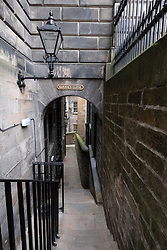 View along Barrie's Close in Edinburgh Old Town, Scotland, UK