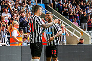 Joselu (#21) of Newcastle United celebrates Newcastle United's first goal (1-1) with DeAndre Yedlin (#22) of Newcastle United during the Premier League match between Newcastle United and Tottenham Hotspur at St. James's Park, Newcastle, England on 11 August 2018.