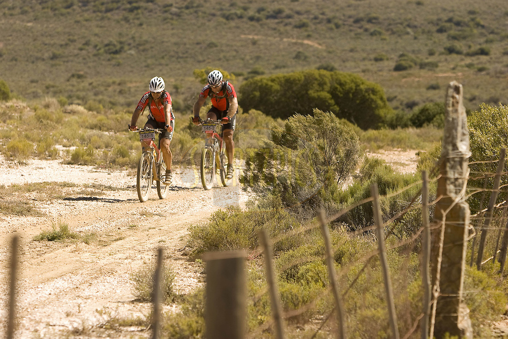 WESTERN CAPE, SOUTH AFRICA -  31 March 2008, Tiaan Strauss and partner Petrus Senekal  during stage three of the 2008 Absa Cape Epic Mountain Bike stage race from Calitzdorp Spa.to Langenhoven High School in Riversdale, Western Cape, South Africa..Photo by Karin Schermbrucker/SPORTZPICS