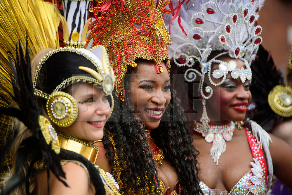 © Licensed to London News Pictures. 29/08/2016. London, UK. Carnival goers enjoy day two of the Notting Hill carnival, the second largest street festival in the world after the Rio Carnival in Brazil, attracting over 1 million people to the streets of West London.  Photo credit: Ben Cawthra/LNP