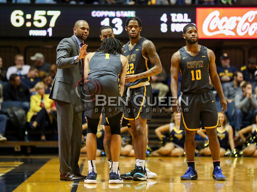 Dec 20, 2017; Morgantown, WV, USA; Coppin State Eagles head coach Juan Dixon talks to his team during the first quarter against the West Virginia Mountaineers at WVU Coliseum. Mandatory Credit: Ben Queen-USA TODAY Sports