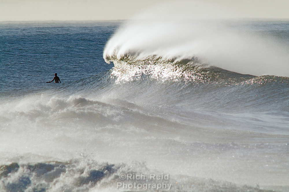 One surfer sitting in the waves at Ventura Point from Emma Wood State Park in Ventura, California.