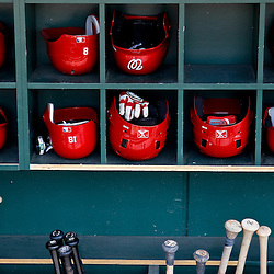 March 24, 2012; Sarasota, FL, USA; A detail of Washington Nationals bats and batting helmets in the dugout for a spring training game against the Baltimore Orioles at Ed Smith Stadium.  Mandatory Credit: Derick E. Hingle-US PRESSWIRE