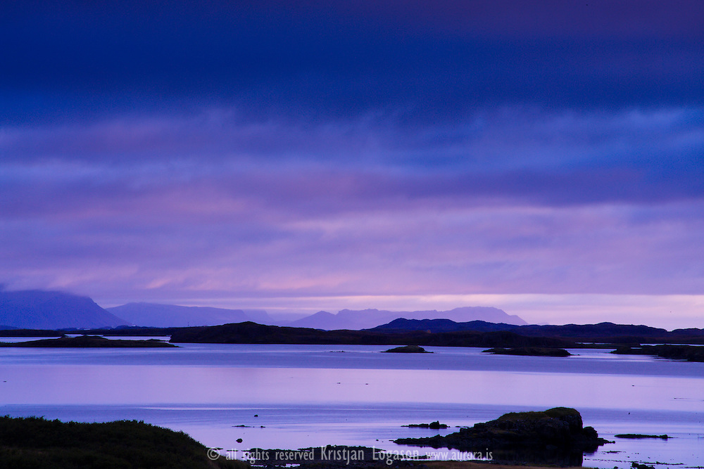 Blue light at midnight over the Islands of Breidafjordur bay in west Iceland