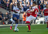 Football - 2018 / 2019 Premier League - Tottenham Hotspur vs. Arsenal<br /> <br /> Moussa Sissoko (Tottenham FC) braces himself as Laurent Koscielny (Arsenal FC) comes in to tackle at Wembley Stadium.<br /> <br /> COLORSPORT/DANIEL BEARHAM