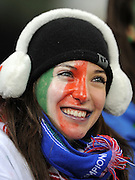 An Italian fan  with a painted face watches during the 2010 FIFA World Cup South Africa Group F match between Italy and Paraguay at Green Point Stadium on June 14, 2010 in Cape Town, South Africa.