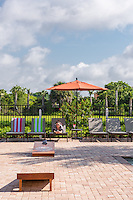 Lifestyle photo of the pool at Palm Ranch in Davie Florida by Jeffrey Sauers of Commercial Photographics, Architectural Photo Artistry in Washington DC, Virginia to Florida and PA to New England