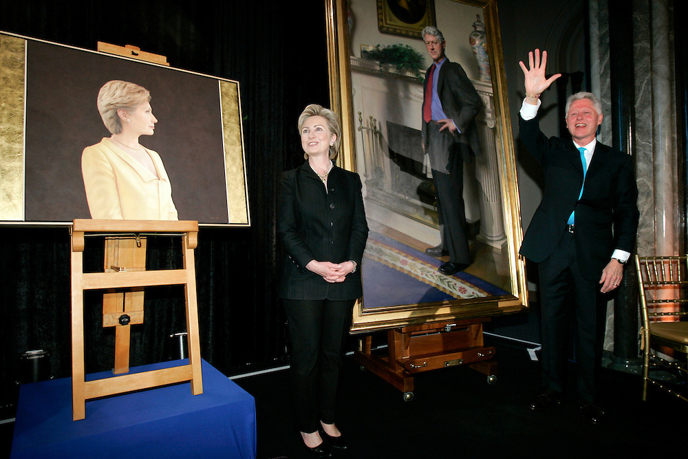 Former U.S. President Bill Clinton and his wife U.S. Senator Hillary Clinton (Democrat / New York) stand next to their portraits during an unveiling ceremony at the Smithsonian Castle in Washington, DC Monday 24 April 2006. The portraits, painted by Nelson Shanks (Mr. Clinton) and Ginny Stanford (Mrs.'s Clinton), will be displayed in the National Portrait Gallery in Washington when the recently restored building reopens in July. This was the first time the gallery commissioned portraits of a Presidential and First Lady at the same time.