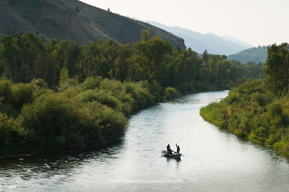 Anglers fly fish from a drift boat on a side channel of the Snake River, Idaho.
