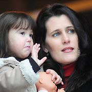 11/28/08 -- NAVAL AIR STATION BRUNSWICK, Maine. Emily Wiese, 2, and her mother, Kari, wave off Emily's father, Cmdr. Eric Wiese, Commanding Officer of VP-8. The Brunswick-based P-3 squadron is deploying today. Because NAS Brunswick is on the BRAC list, Cmdr. Wiese and his crew will return to Jacksonville, Fla. -- not Brunswick -- after their deployment. Photo by Roger S. Duncan.