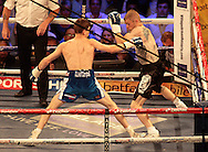 Picture by Richard Gould/Focus Images Ltd +44 7855 403186<br /> 13/07/2013<br /> Luke Campbell (blue shorts) and Andy Harris pictured during their Lightweight contest at Craven Park, Hull.