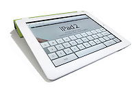 Apple iPad2 showing keyboard photographed on a white background.