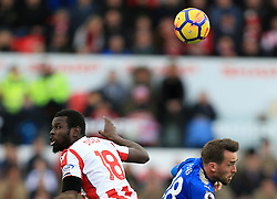 Mame Biram Diouf of Stoke City and Christian Fuchs of Leicester City battle for a header - Mandatory by-line: Paul Roberts/JMP - 04/11/2017 - FOOTBALL - Bet365 Stadium - Stoke-on-Trent, England - Stoke City v Leicester City - Premier League