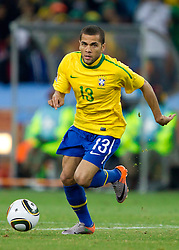 Dani Alves of Brazil during the 2010 FIFA World Cup South Africa Group G Second Round match between Brazil and République de Côte d'Ivoire on June 20, 2010 at Soccer City Stadium in Soweto, suburban Johannesburg, South Africa.  Brazil defeated Ivory Coast 3-1. (Photo by Vid Ponikvar / Sportida)